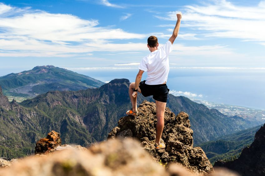 man on top of mountain, invigorated