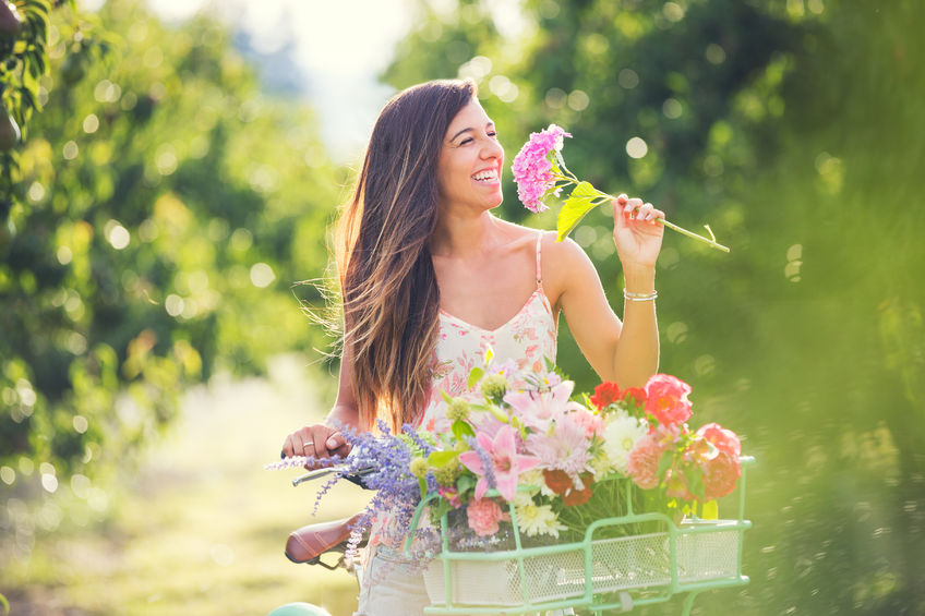 healthy woman in the part with flowers inositol