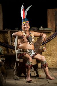 Amazon shaman in chair