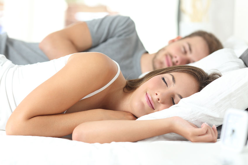 happy couple sleeping in a comfortable bed at home thanks to theanine