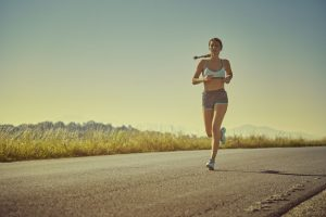 Quercetin side effects: active sporty woman in summer sportswear running
